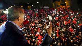 Turkey's President Recep Tayyip Erdogan addresses cheering supporters after unofficial referendum results were announced, in Istanbul. Picture: Yasin Bulbul/Presidential Press Service via AP