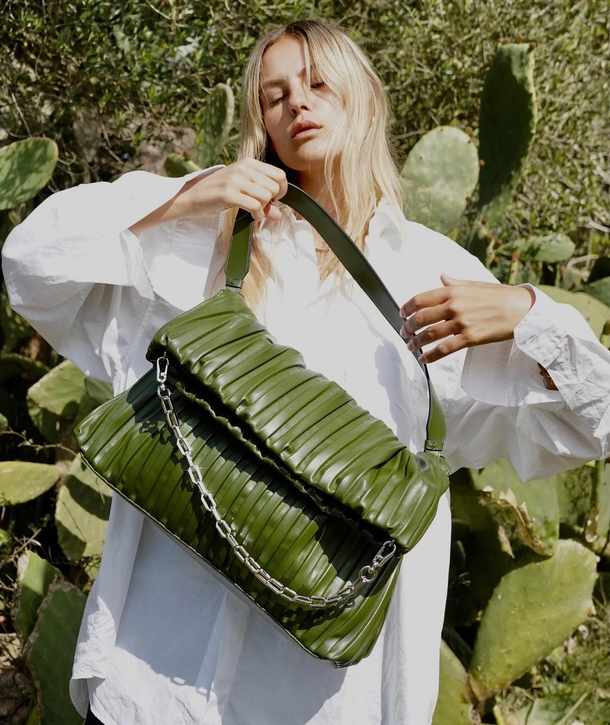 Model Amber Valletta designs cactus leather handbag for Karl Lagerfeld accessories collection