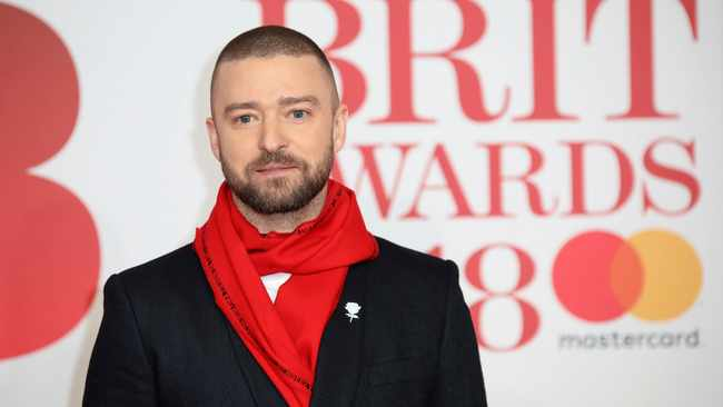 Singer Justin Timberlake poses for photographers upon arrival at the Brit Awards 2018 in London, Wednesday, Feb. 21, 2018. (Photo by Vianney Le Caer/Invision/AP)