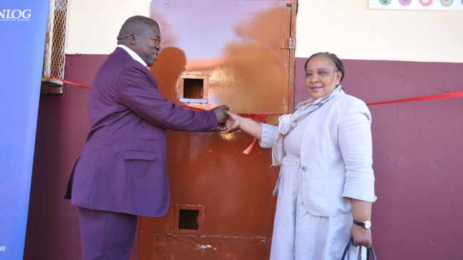 Acting chief director from Department of Education in Bojanala district Pauline Mokutle, right, and Moses Kotane local municipality councillor, Hendrick Sekao, cut the ribbon to officially open science laboratory at Malefo Secondary School outside Rustenburg. Picture: ANA Reporter