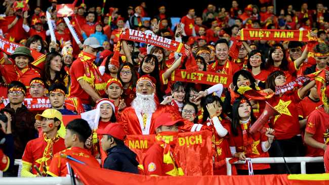 In this Dec. 15, 2018, photo, Vietnam's spectators cheer during the AFF Suzuki Cup final match between Vietnam and Malaysia at My Dinh stadium in Hanoi, Vietnam. (AP Photo/Minh Hoang)