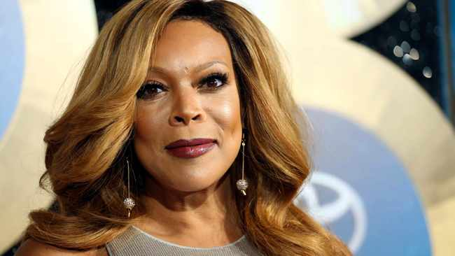 FILE - In this Nov. 7, 2014, file photo, TV talk show host Wendy Williams arrives during the 2014 Soul Train Awards in Las Vegas. Williams' family says she is taking an extended break from her TV talk show to deal with health issues. In a statement Friday,  Jan. 18, 2019, the family said that Williams has suffered complications from the Graves' disease in the past few days. (Photo by Omar Vega/Invision/AP, File)