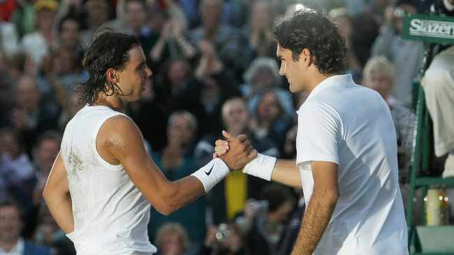 In this 2008 file photo Spain's Rafael Nadal left, shakes the hand of Switzerland's Roger Federer after winning the men's final on the Centre Court at Wimbledon. After going more than 1½ years without playing each other anywhere, Roger Federer and Rafael Nadal will be meeting at a second consecutive Grand Slam tournament when they face off in Wimbledon's semifinals. Photo: Anja Niedringhaus/AP Photo