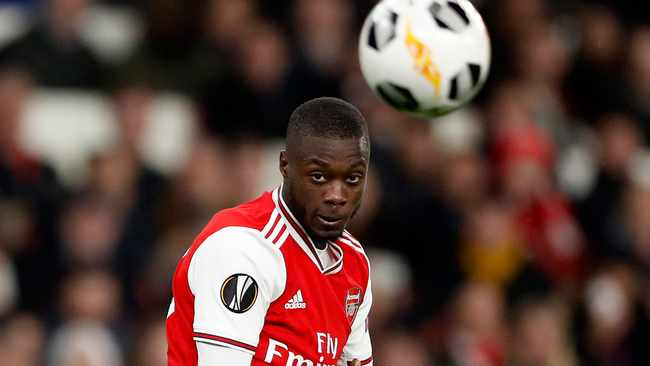 Arsenal's Nicolas Pepe scores his side's second goal from a free kick during the Europa League group F soccer match between Arsenal and Vitoria SC. Photo: AP Photo/Alastair Grant
