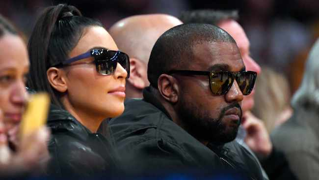Kim Kardashian, left, and rapper Kanye West watch during the second half of an NBA basketball game between the Los Angeles Lakers and the Cleveland Cavaliers, Monday, Jan. 13, 2020, in Los Angeles. Picture: AP
