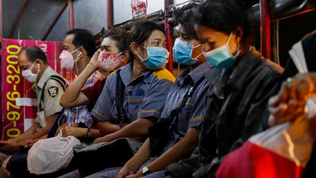 Bangkok residents travelling on a bus in Thailand. Picture: Reuters