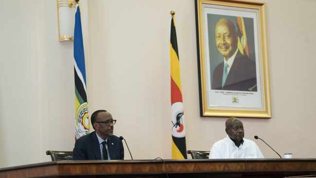 Rwandan president Paul Kagame, left, and Ugandan President Yoweri Museveni hold a press conference after their meeting at the State House in Entebbe, Uganda last year. Picture: Michele Sibiloni/AFP