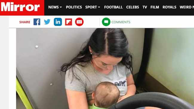 """This is the moment a young mother was forced to breastfeed her son sitting on a """"filthy"""" train floor because passengers would not give up their seats. Picture: www.mirror.co.uk screenshot"""