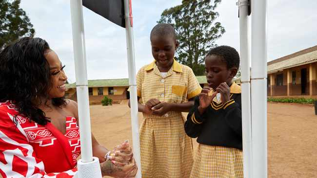 Lifebuoy ambassador DJ Zinhle demonstrates to schoolgirls how to properly wash hands with soap at Nyamazane Primary School on Tuesday, which was the World Handwash Day. Picture: Supplied