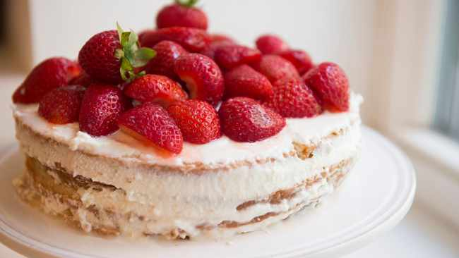 This version of Sicilian cassata, a spongecake layered with sweetened ricotta, is crowned with juicy fresh berries. Picture: Evan Sung/The New York Times