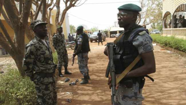Malian soldiers stand in guard in Kati, outside Bamako. File photo: Luc Gnago/Reuters