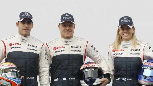 Williams Formula One drivers Pastor Maldonado (L), Valtteri Bottas and test-driver Susie Wolff pose with the 2013 FW35 race car.
