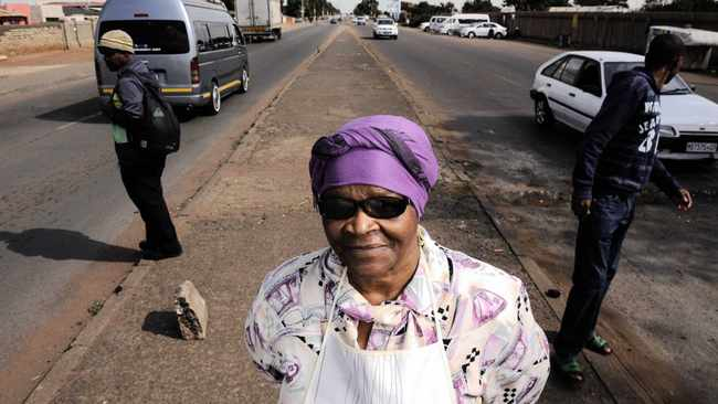 The dividing line of Khumalo Street. Cresencia Buthilezi's son was killed during the political violence of the 1990s in Thokoza. Many of the victims of the political violence that occured in and around Khumalo Street in Thokoza during the early 1990s were never identified. 100414. Picture: Chris Collingridge 548