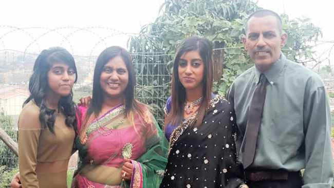 Sagren Govindasamy with his wife, Jane, and their daughters, Rackelle, left, and Denisha, right. Sagren is the sole survivor in the family.