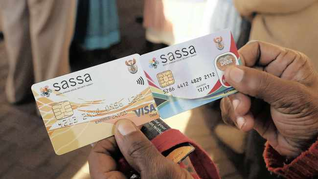 THE new Sassa card, left, and the old one.     Simphiwe Mbokazi African News Agency/ANA