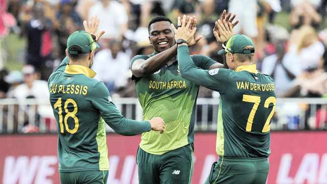 LUNGI NGIDI celebrates with Faf du Plessis and Rassie van der Dussen during the third ODI against Sri Lanka at Kingsmead.