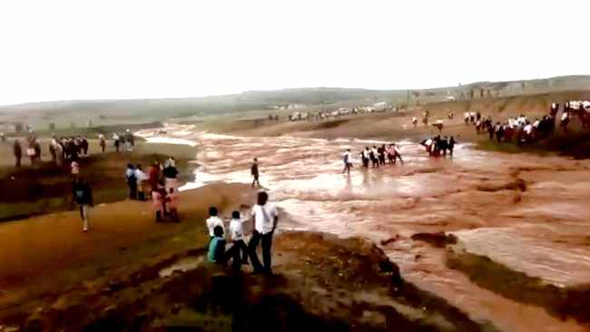 screengrabs from a video taken earlier this week of pupils and the community pondering how to cross a river in the Bergville area that nearly washed away a child and car after heavy rains. There is no bridge in the KwaMaye area of Bergville, and pupils and cars cannot cross, they have to wait for the water to subside.