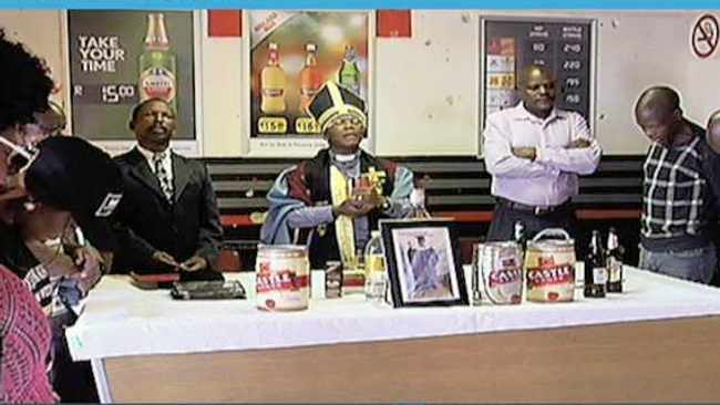 A TV screenshot of alcohol-drinking congregants. Picture: Facebook