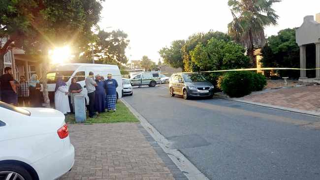 Neighbours stand outside the cordoned-off Ottery residence where the elderly couple were found slain. Picture: Supplied
