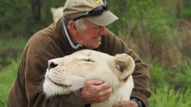 West Mathewson with one of his beloved white lionesses. Picture: Facebook / Lion Tree Top Lodge