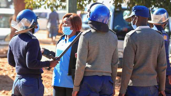 Police arrest a health worker during a protest against economic hardship and poor working conditions during the Covid-19 outbreak in Harare. File picture: Philimon Bulawayo/Reuters