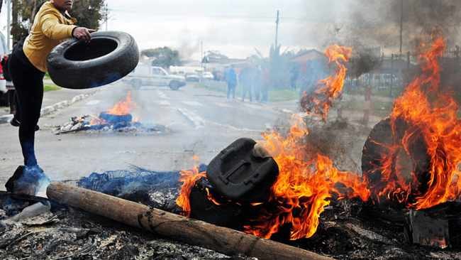 Cape Town - 150824 - Langa backyarders and residents took to the streets burning tyres, couches, beds and anything combustible they could find in protest against housing waiting list irregularities. They claim people new to the area have been getting houses even though they have been on the housing list for a long time. Reporter: Porchia Olifant Picture: David Ritchie