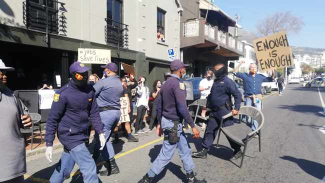 Police remove tables and chairs in a Cape Town CBD street during the restaurant industry's #JobsSaveLives protest, which took place countrywide from noon to 2pm on Wednesday. Video: Ayanda Ndamane / African News Agency (ANA)