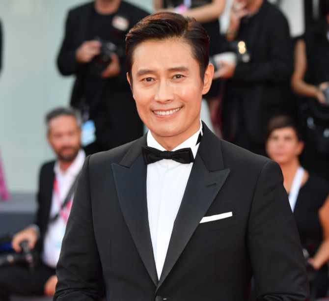VENICE, ITALY – AUGUST 30:  Lee Byung Hun walks the red carpet ahead of the 'Roma' screening during the 75th Venice Film Festival at Sala Grande on August 30, 2018 in Venice, Italy.  (Photo by Stephane Cardinale – Corbis/Corbis via Getty Images)