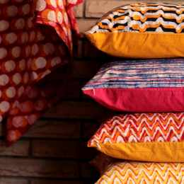 Bring a little spring into your bedroom with vibrant accent pillows
