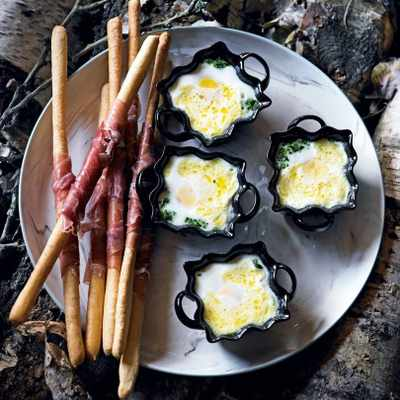 Eggs en cocotte with spinach purée & prosciutto fingers